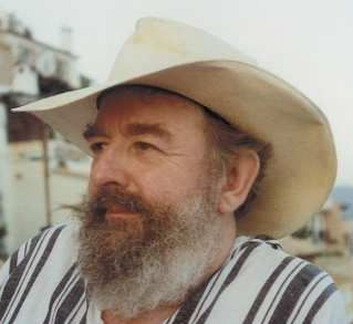 photo of article author Michael Moorcock wearing a cowboy hat