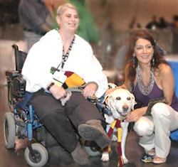 photo of lady in a wheelchair with a guide dog